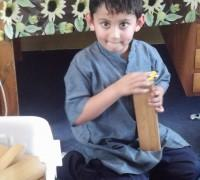 Rushi builds with big wooden blocks